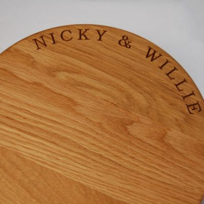 Round engraved oak cheese board, size 30cm diameter x 4cm, font Bookman Old Style