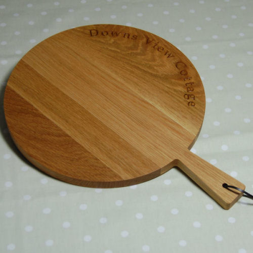 Personalised wooden paddle board, size 30cm dia x 1.8cm, font Book Antiqua