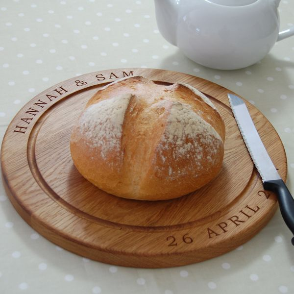 Personalised bread board, size 38cm dia x 2.7cm, font Bookman Old Style