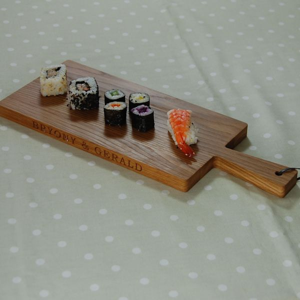 Personalised wooden paddle serving board