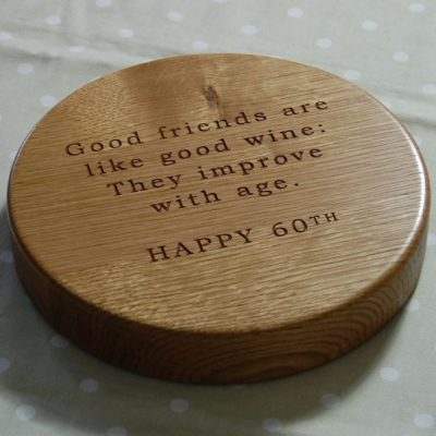 60th birthday personalised wooden chopping board, size 23 dia x 4cm, font Bookman Old Style