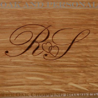 Personalised motif comprising intertwined hearts and initials
