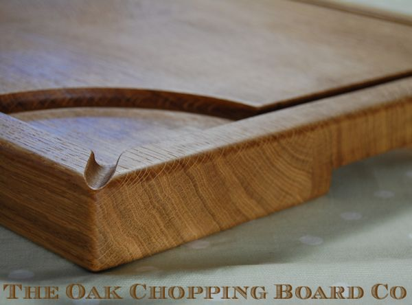 Wooden carving board with pouring spout and handles