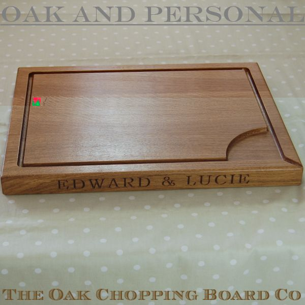 Large personalised wooden carving board with pouring spout, size 38x50x4cm, font Bookman Old Style