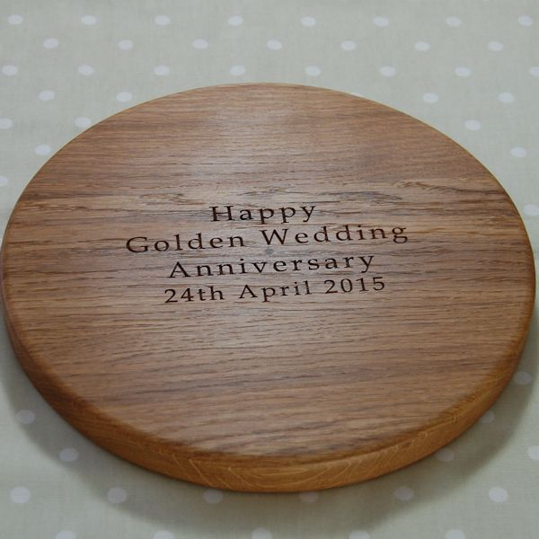 Golden wedding anniversary cheese board, size 30 dia x 2.7cm, font Book Antiqua