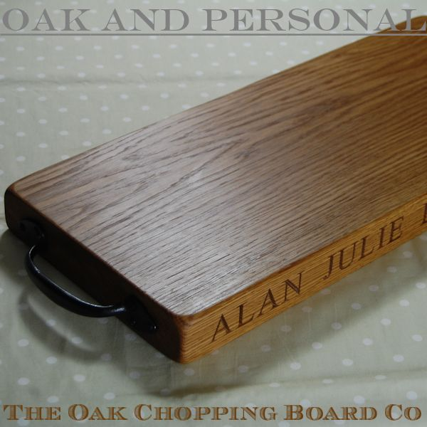 Personalised rustic wooden serving board with wrought iron handles