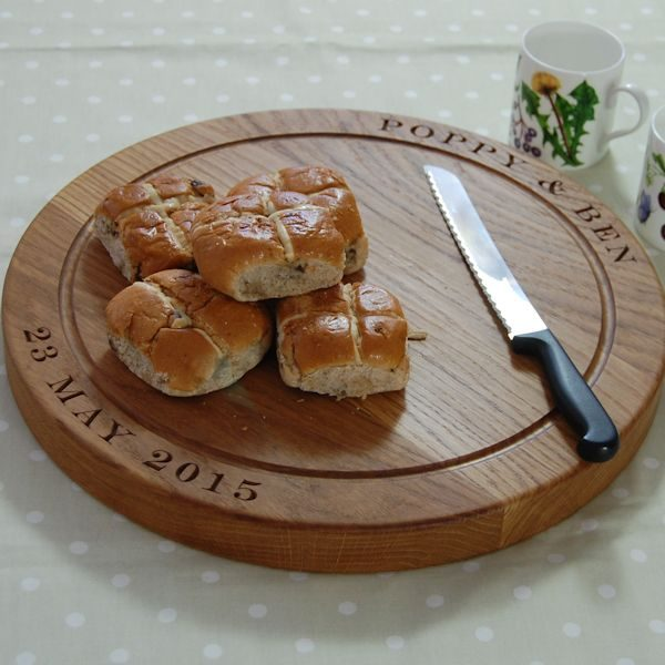 Personalised wooden bread board, size 42.5 dia x 4cm, font Engravers MT