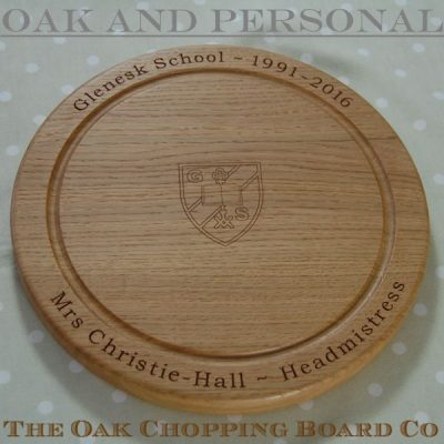 Engraved wooden chopping board, size 30 dia x 2.7cm, font Bookman Old Style, school crest