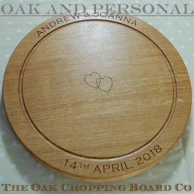 Personalised wooden chopping board, size 42.5 dia x 4 cm, font Copperplate Gothic, optional entwined hearts motif
