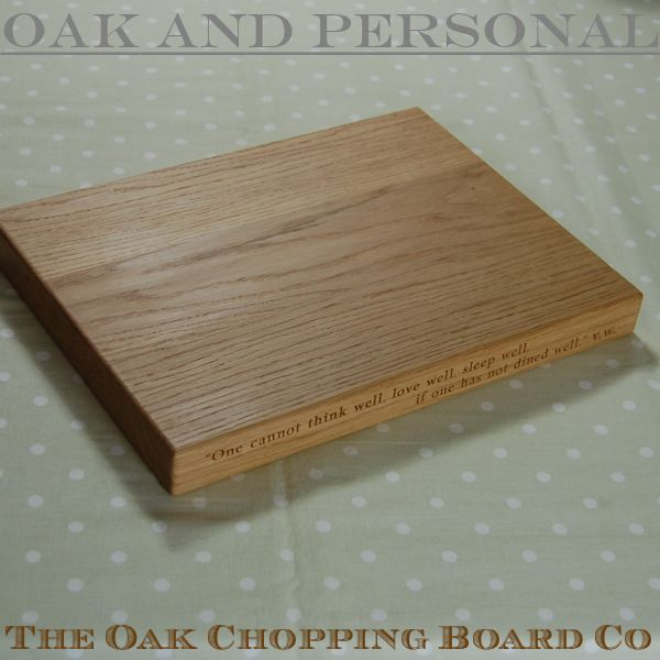Personalised wooden chopping board with 2 lines of text, font Byington
