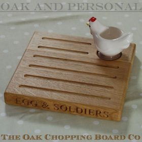Personalised wooden egg and toast board complete with ceramic chicken egg cup