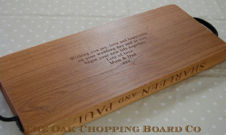 Rustic engraved oak serving board with wrought iron handles and engraved hidden message on underside