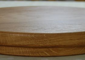 Circular wooden sink chopping board, profile view