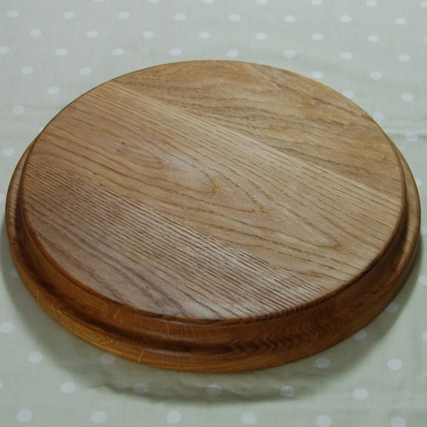 Circular wooden sink chopping board, size 30 dia x 4cm (view of underside)